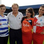 Neil Warnock manager of Queens Park Rangers with Airline stewardesses from Malaysian Airlines and Air Asia wearing the new club kit