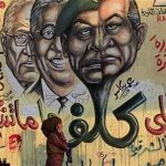 A girl walks past a mural depicting a combination of the faces of Egypt's former president Hosni Mubarak and Field Marshal Mohamed Hussein Tantawi in Cairo