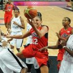 Taurasi of the U.S. vies with Angola's Guadalupe and Tomas during their Women's preliminary round group A basketball match in the London 2012 Olympic Games