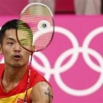 China's Lin Dan plays against Ireland's Scott Evans during their men's singles group play stage Group P badminton match during the London 2012 Olympic Games at the Wembley Arena