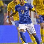 Brazil's Neymar and Sweden's Granqvist fight for the ball during their friendly at Rasunda stadium in Stockholm