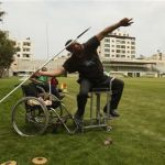 Palestinian Paralympic athlete Zaqout throws the javelin during a training session in Gaza City