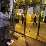 Protester steps on drawing of Japanese national flag outside where Japanese Consulate is located in Hong Kong