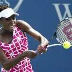 Chanelle Scheepers of South Africa hits a return shot to Venus Williams of the U.S. during their second round match in the 2012 Cincinnati Open tennis tournament in Cincinnati