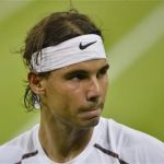 Rafael Nadal of Spain reacts in his men's singles tennis match against Lukas Rosol of the Czech Republic at the Wimbledon tennis championships in London