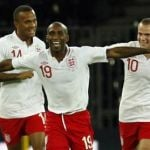 England's Defoe celebrates with team mates Bertrand and Cleverley after scoring against Italy during their international friendly football match in Bern