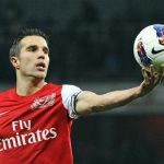 Arsenal's van Persie catches the ball during their Premier League match against Newcastle United in London