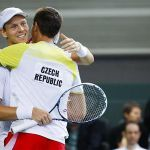 Berdych of the Czech Republic celebrates with his team mate Rosol after winning his Davis Cup world group round 1 tennis doubles match against Wawrinka and Chiudinelli of Switzerland at Palexpo in Geneva