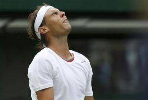 Rafael Nadal of Spain reacts during his men's singles tennis match against Steve Darcis of Belgium at the Wimbledon Tennis Championships, in London