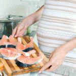 pregnant-woman-cooking-fish