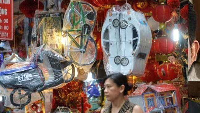 Vietnamese furnish ancestors with jets, rollers and mansions