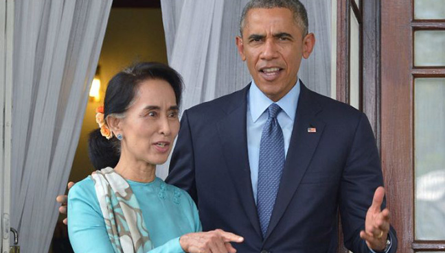 Obama vows to lift Myanmar sanctions as Suu Kyi visits