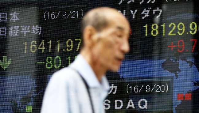 BOJ overhauls policy, sets yield curve target