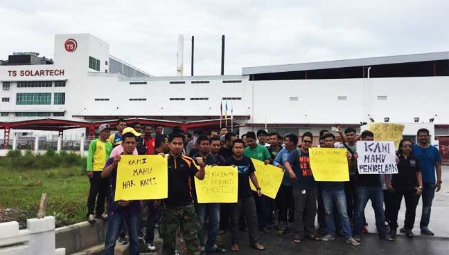 Laid-off through SMS in 24hrs, factory workers protest