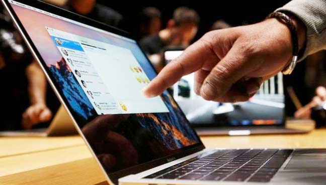 Apple-adds-touch-screen-keys-to-MacBook-Pro,-price-jump-startles-some