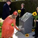 King Willem-Alexander and Queen Maxima of the Netherlands place sunflowers at the MH17 Memorial at Parliament House in Canberra.