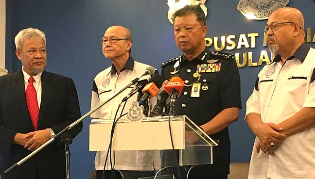 Penang police chief Chuah Ghee Lye (second right) says police cannot do anything to Selva Kumar if he does not violate the law.