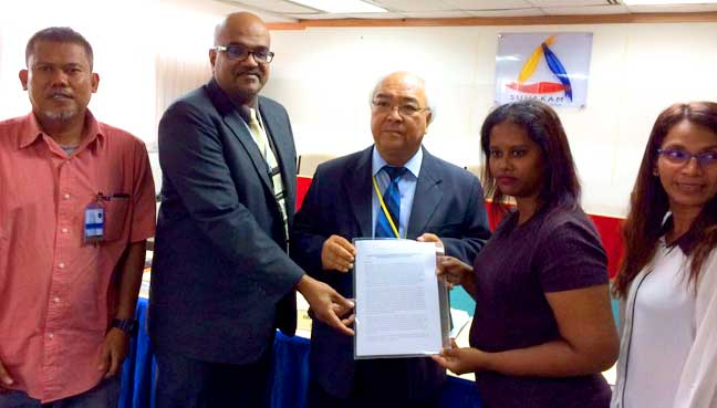 Activist Lena Hendry (second from right) hands over her complaints to Suhakam commissioners Mah Weng Kwai (middle) and Jerald Joseph (second from right)