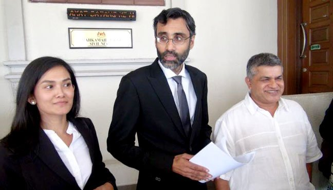 Cartoonist Zunar (right) and his lawyers N Surendran (middle) and Melissa Sasidaran (left) at the KL High Court, after the decision on Zunar's travel ban.
