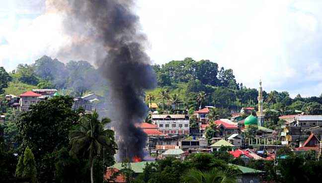 Philippines says militants control 20 percent of besieged city