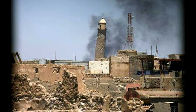 IS militants destroy 12 century mosque in Iraq's Mosul