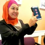 Nor Aleeshah Abdullah, EzCab executive director, demonstrating the use of the SOS button - it's latest feature in the app.