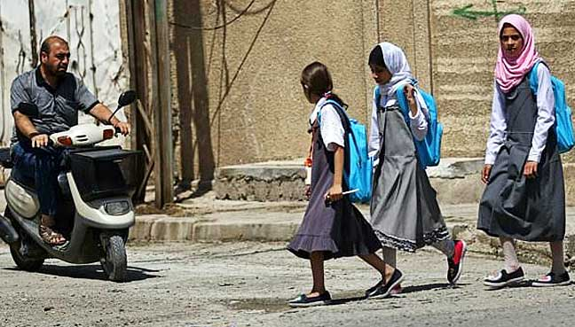 Schoolgirls-in-Iraq's-Mosul-aim-to-catch-up-on-lost-years