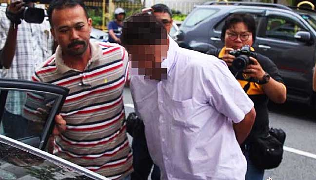 Penang DAP aide under molest probe released from remand