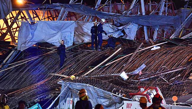 One dead as under-construction Singapore highway collapses