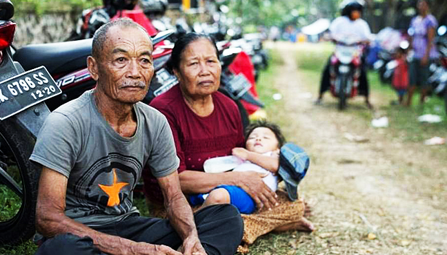 Bali volcano evacuees outside danger zone told to go home