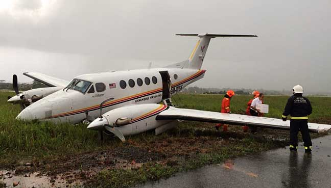 Plane with minister, 5 others skids off Kuching airport runway
