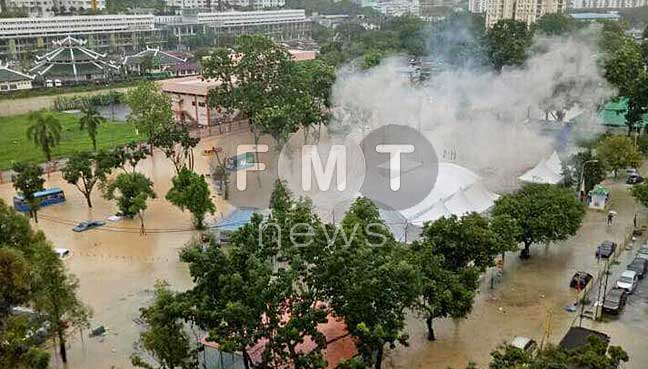 Smoke emanating from a TNB substation in Taman Thean Teik, Air Hitam. Many households in the area are now experiencing power failure due to the floods.