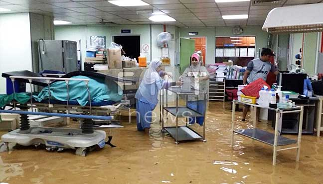 A government clinic in Penang inundated with flood waters.