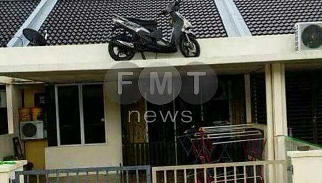 Many have resorted to storing their valuables on the rooftops of their houses, including an individual who hoisted his motorcycle above the porch.