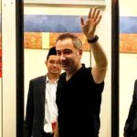 Mustafa Akyol waves as he prepares to board his flight at the Kuala Lumpur International Airport last night.