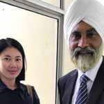 Sua Lai Kim with lawyer Jagjit at the Butterworth Sessions Court.