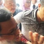 Shafie Apdal being led into the Kota Kinabalu Magistrate's Court.