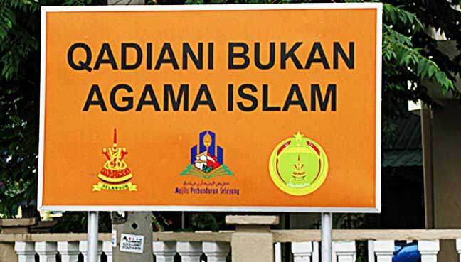 A giant signboard by Islamic authorities condemning the Ahmadiah sect greets visitors at Baitusalam in Batu Caves.