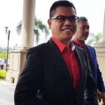 Red Shirts Leader Jamal Md Yunos walking into the Kuala Lumpur Court complex to file a defamation suit against Ampang MP Zuraida Kamaruddin over apology claim.