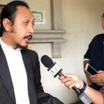 Lawyer Haijan Omar (left) representing two teenage siblings implicated in the tahfiz school fire, speaking to reporters after the magistrate court's order to the boys to serve two months in jail from Sept 16.