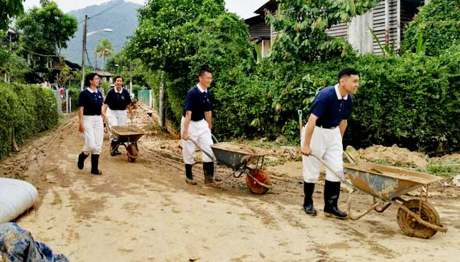 A street in Kg Shaik Madar. The village is city council owned and rented out to people at a cost of RM75 a month. Pictured are Tzu Chi Foundation members, outnumbering council workers.