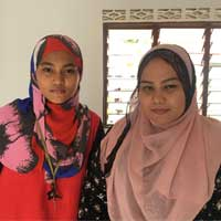 Leniyusnita Amrizal (right) with her sister. Their house is 500 metres away from the highwayconstruction area.