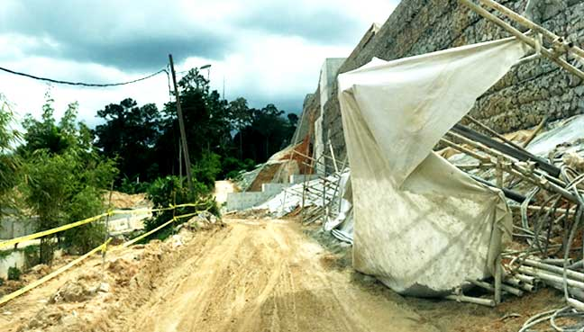 Road to the Maahad Tahfiz Darul Huffaz, near the construction site of the highway.