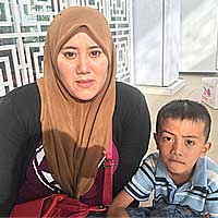 Nur Safrina Ariffin, 36, with her youngest son.