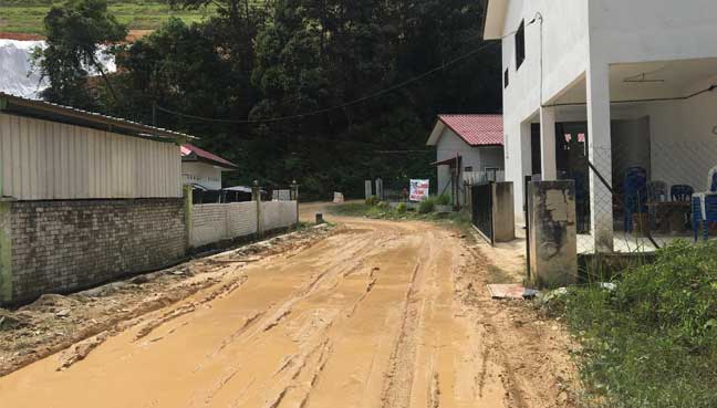The muddy road in front of the tahfiz school.