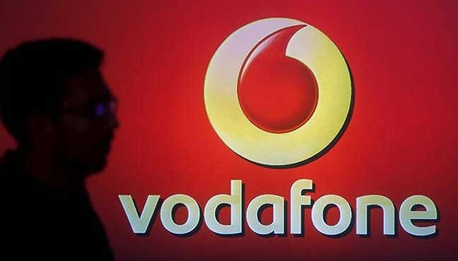 Vodafone raises full-year outlook after strong first half