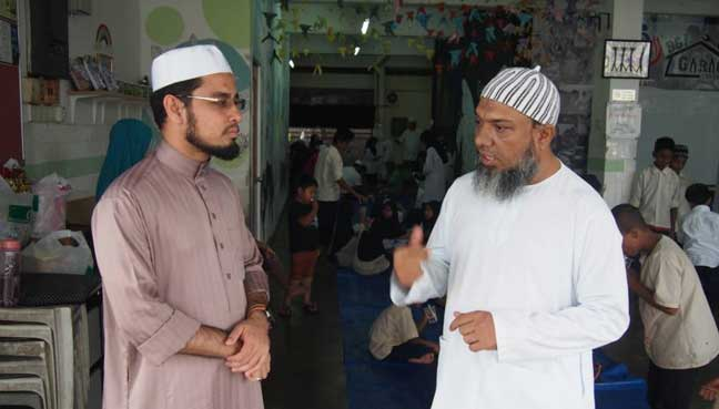From left volunteer teacher Burhanuddin, 27, who is a student with the International Islamic University (IIUM) and Rafiq Ismail, 42, principle of Pelangi Kasih