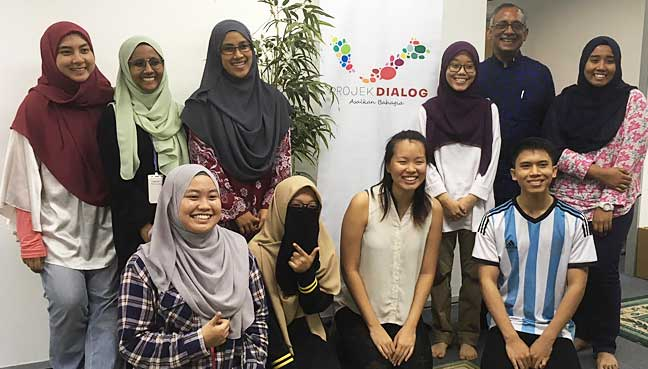Participants of the forum, titled 'Tuhan Yang Hijau', pose for a picture.