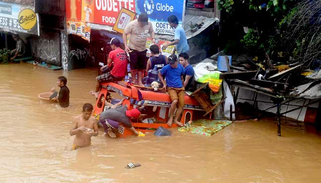 Nearly 90 dead in Philippine mudslides, flooding as storm hits