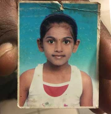A passport size photograph of M. Vasanthapriya when she was 9. Muniandy Ratnam keeps the photograph in his wallet.